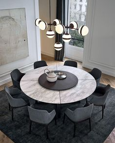 27 Perfect Round Dining Table Design Ideas For Inspiration. A round pedestal dining table is perfect if you want to make your dinning room look modern yet timeless. Round Dining Table Modern, Dining Table Design, Contemporary Dining Table, Round Dining Tables, Contemporary Design, Entry Tables, Oval Table, Contemporary Kitchens, Elegant Dining