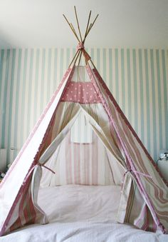 Wouldn't your kids love to have a teepee over their bed?  It looks like these have 6 poles.  Here's a tutorial for a hexagonal tent.  Here's...