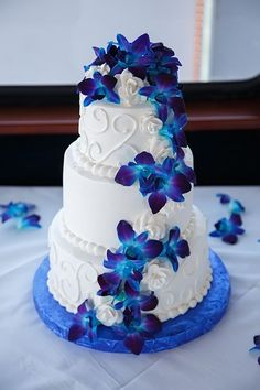 Round White Wedding Cake with Swirls and Blue Orchid Flowers #flowercakes