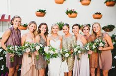 Beautiful bride with her bridesmaids...loving the glitter metallic bridesmaids and jewelry!