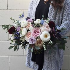 A bridal bouquet for Emilie with the perfect cool palette of dusty purple, light blue and a touch of rich burgundy. Congratulations beautiful bride! Designed by @heather_page