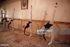 Ballet students at the Vaganova Ballet School, formerly the Imperial Ballet Academy, stretch at the bar beneath a portrait of Agrippina Vaganova who reigned over the school from 1921 to 1951.