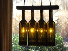Wine bottles turned into a beautiful lighting unit. What a gorgeous way to set a romantic mood!