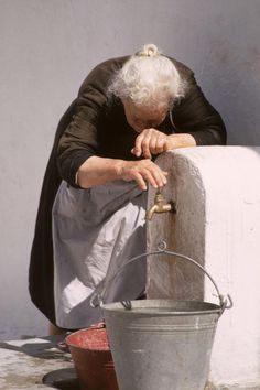 *GREECE ~ Old Lady With Water Pail is a photograph by Carl Purcell which was uploaded on September 2010 Water Pail, Water Spout, Water Bucket, People Around The World, Old Women, Old Ladies, Belle Photo, Illustrations, In This Moment