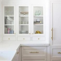 White Kitchen Handles white shaker cabinetry with brass cups and knobs -rafterhouse