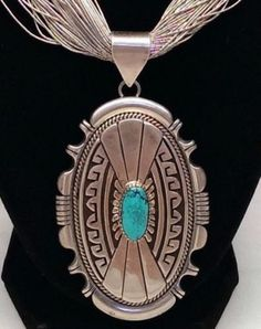 Sterling Silver Turquoise Pendant....hmmm, bring out the old liquid silver chains?