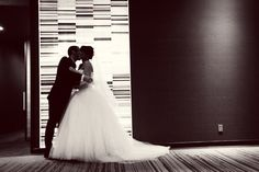 Sneaking away for a kiss. Photo by Shinano. #Graves601Hotel #WeddingPhotographersMN