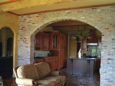 brick arch and the island also ceiling beams