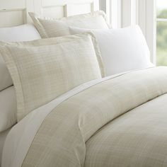 Protect your comforter and improve the presentation of your bedroom with our beautiful Thatch Patterned 3-Piece Duvet Cover Set. Made with the finest microfibers, this classic piece is utterly soft and smooth. Our Duvet Cover provides the highest quality due its durability, stain repelling feature, and overall long lasting nature. With 11 stunning colors, this piece is perfect for any style. Included in the 3-piece set are two matching pillow shams along with the duvet cover.