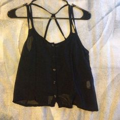 Sheer black tank top NOT Brandy.!!only listed it for views. however it looks like Brandy. really cute sheer black tank top to wear over a bandeau or bikini top. no tag at all, but I would say it's a small/xs. Brandy Melville Tops Tank Tops