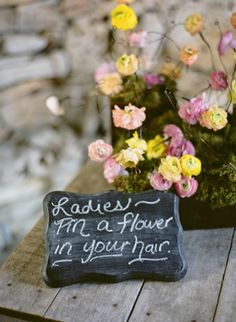 sweet idea - set out flowers for female guests to pin in their hair | photo by Tanja Lippert
