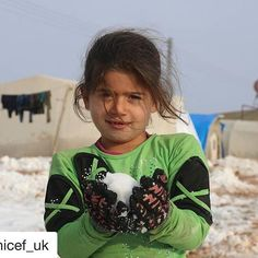 """#Repost @unicef_uk with @repostapp ・・・ Despite the chilly temperatures, this young girl is ready to play in the snow with her friends. She left her home in Syria and now lives at the Al-Nour camp for displaced people. """"I wish I have my yellow coat that I love,"""" she said. """"I used to wear it when it snowed and I never felt cold then"""". We're working in Syria to make sure that children and families have warm clothes to beat the winter chill. Photo: Unicef 2016 Alwan #snow #cold #winter #chilly…"""
