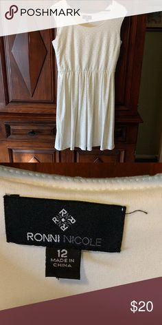 Ronnie and Nicole white eyelet dress Beautiful white eyelet dress, great with belt. Ronnie and Nicole Dresses