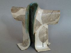 Ceramic kimono with pressed leaves by Rachel Minor Pottery Designs, Pottery Ideas, Pressed Leaves, Clay Studio, Clay Figures, Kaftans, Cuff Bracelets, Kimono, Japan