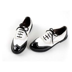 New.+Black+and+white+oxford+flats.+Wing-tipped+toe.+Vegan+leather. Available+in+US+women's+sizes+6,+6.5,+7,+7.5,+8,+8.5,+9,+and+9.5. Item+is+sent+direct+from+manufacturer;+may+need+to+be+aired-out;+<b>please+wait+3-8+weeks+to+arrive.</b>+No+shipping+in+October.
