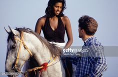 Stock Photo : Young woman on horseback talking to man
