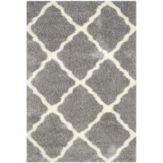 Create a stylish foundation in the living room or den with this eye-catching rug, showcasing a trellis design in ivory and gray.  Pr...