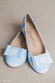 Tarheel blue and white striped ballet flats with a UNC bow / perfect shoes to sport during football season tailgate or a March Madness party / Shoes are by @lillybeeU / Photo by @jnwhitt of Fancy This Photography / @SthrnBrideGroom / southernbrideandgroom.com