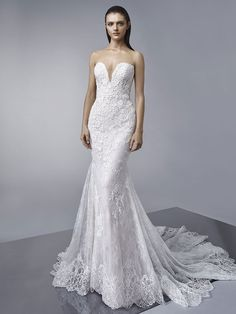 Megan: The modern mermaid dress of your dreams -- this full-length gown features a sultry, plunging neckline with scalloped lace edging, exquisite chantilly overlace with beaded, embroidered lace, a gorgeously flared train, and delicate covered buttons along the invisible back zipper closure.