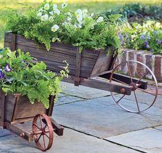 Small and large wood wheelbarrow planter