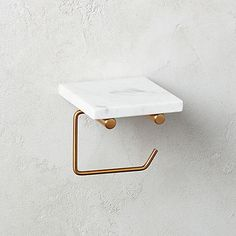 White Marble Wall Mounted Toilet Paper Holder with Shelf: modernity, redefined. Shop Canada to get the effortlessly on-trend look you're craving.