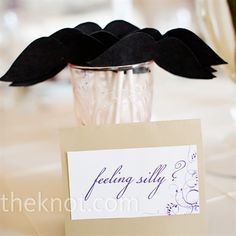 Stephanie and Justin set out paper mustaches for guests to wear in the photo booth.