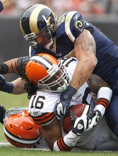 Linebacker James Laurinaitis #55 of the St. Louis Rams tackles wide receiver Joshua Cribbs #16 of the Cleveland Browns kThis post has 4 not...