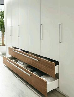 Cool idea of center drawers to access more storage.