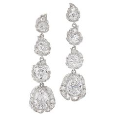 Edwardian Diamond Platinum Stylized Flower Bud Pendant Earrings | From a unique collection of vintage dangle earrings at https://www.1stdibs.com/jewelry/earrings/dangle-earrings/