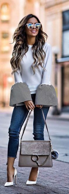 white bell sleeved top with mirrored sunglasses, cropped jeans, heels and a gray handbag. #stylish #fashionblogger #chic #heelsandjeans