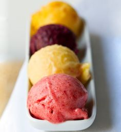 Summer sorbets. Made with a blender and frozen in a metal bowl. Strawberry Banana, Banana Pineapple, Zippy Wild Blueberry and Spicy Mango recipes.