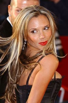 We'd forgotten Victoria Beckham had long blonde hair at one point - we think it looks hot!