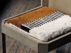Here's a treat for the eyeballs and the derrière: Japanese hand-woven chair mats that double as floor cushions.