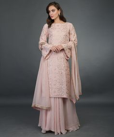 From our Wedding Festive Collection, this is a nude pink pure georgette palazzo suit with intricate exquisite rose gold gota patti hand embroidery. The shirt has rose gold gota patti hand embroidery all over in lattice pattern. The pure Georgette Lehenga Skirt, Anarkali, Sharara, Indian Suits, Indian Wear, Pakistani Dresses, Indian Dresses, Gota Patti Suits, Work Suits