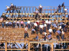 Amish barn raising. Many hands make light work. Their craftsmanship is the best.
