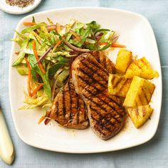Chops and Pineapple with Chili Slaw  ...      Chile powder adds a touch of heat to these grilled pork chops. For a refreshing side dish, we've tossed cabbage, onion, and sweet pepper in a five-ingredient dressing.
