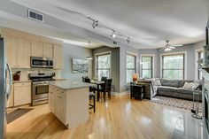 This 2-bedroom apartment in Lakeview has an open floor plan and shiny hardwood floors.