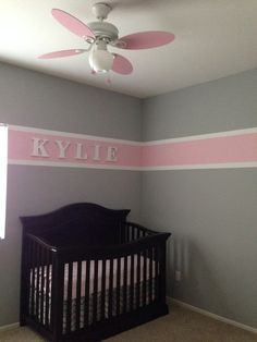 We finished Kylie's nursery! Got the stripe idea from another pin and so in love with how it turned out! Pink and gray nursery. Baby girl nursery. #nursery