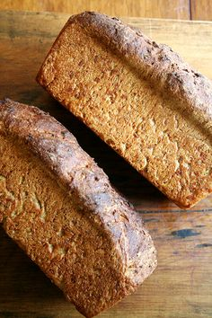 No-Knead Oatmeal Bread  Yield = 2 loaves    3/4 cup brown sugar  1 tablespoon kosher salt  1 3/4 cups old-fashioned oats  3 cups boiling water  2 tablespoons of butter  1 pkg active dry yeast = 2.25 teaspoons  1/4 cup warm water  3 cups all-purpose flour  3 cups whole wheat flour