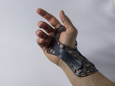 piuLAB's Wrist Brace prints flat, then molds to your body with the help of hot water. It also looks like it's from the future. http://thingiverse.com/thing:403001