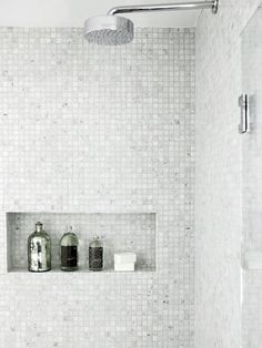 Gorgeous shower design with wall to wall Carrara marble mini mosaic tile and tiled recessed shelf for showering essentials! The shower features a glass door and polished chrome rain fall shower head. Bathroom Shower Organization, Laundry In Bathroom, Small Bathroom, Bathroom Ideas, Bathroom Niche, Bath Ideas, Bathroom Designs, White Mosaic Bathroom, Shower Storage