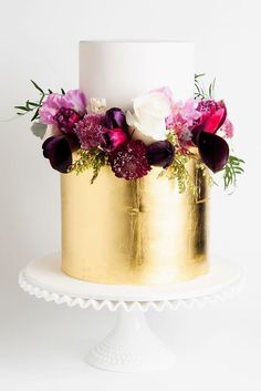 Guilded Gold 2 tier cake with rich toned florals! Amazing Wedding Cake Designers We Totally Love ❤ See more: http://www.weddingforward.com/wedding-cake-designers/ #weddings