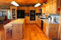 Enjoy fantastic long range views from this exceptional plus office and bonus room, Stonebridge log cabin. Log Cabin Kitchens, Log Cabin Homes, Log Cabins, Kitchen Remodel Cost, Kitchen On A Budget, Kitchen Ideas, Kitchen Renovations, Knotty Pine Kitchen, Kitchen Island Decor