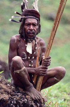 Indonesia | Yali Warrior in full paint & decorations holds poison arrows. Irian Jaya | © Bryan & Cherry Alexander Photography