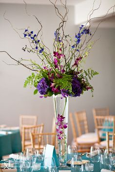 Whatever the type of wedding that needs setting up, it's going to most likely need flowers. A smaller informal wedding or a huge fancy affair will certainly both need to have their share of flowers. Orchid Centerpieces, Tall Wedding Centerpieces, Vase Arrangements, Wedding Decorations, Purple Centerpiece, Anniversary Centerpieces, Wedding Tables, 50th Anniversary, Table Decorations