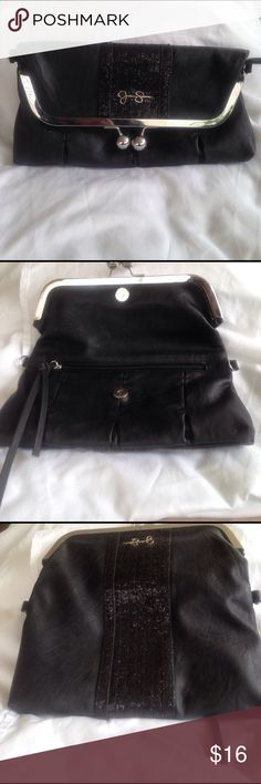 Jessica Simpson clutch Used excellent condition. Very cute and roomy clutch. 11 inches wide and 5 inches tall Jessica Simpson Bags Clutches & Wristlets