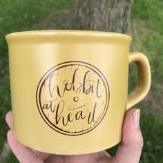 Have a cup of Tea with Tolkien wherever you go, featuring our Hobbit at Heart design created by Fiore Design Studio exclusively for Tea with Tolkien. The mug is a light mustard color, and the design is printed in a vintage-looking distressed style, in a red-brown color. All mugs will ship via USPS Priority Shipping. Shipping cost for mailing fragile items such as mugs is quite high, but if you purchase more than one item from the Tea with Tolkien shop it becomes much more affordable to ship…