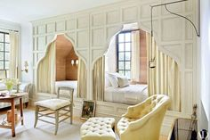 In our roundup of cozy beds nestled in wall nooks, the guest room of this Cape Dutch–inspired house in Baton Rouge, Louisiana, features custom-made box beds accented with curtains of a Chelsea Editions check. The residence was designed by McAlpine Tankersley Architecture and decorated by McAlpine Booth & Ferrier Interiors