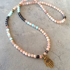 Genuine sunstone, amazonite, and smoky quartz 108 bead necklace with a counter bead every 27 beads, stringed on sturdy  hitec elastic, it wraps as a bracelet and doubles as a midlength necklace with a