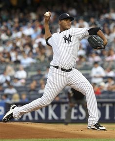 GAME 103: Tuesday, July 31, 2012 - New York Yankees' Ivan Nova pitches during the first inning of a baseball game against the Baltimore Orioles at Yankee Stadium in New York.